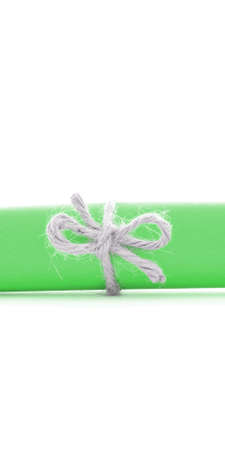natural rope: Handmade natural rope node tied on green letter roll, isolated