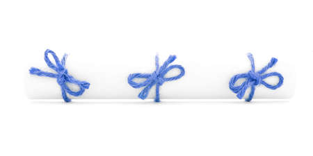 missive: White paper scroll tied with string, three blue knots, isolated Stock Photo