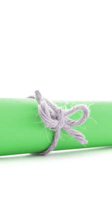 node: Handmade natural rope node tied on green message tube, isolated