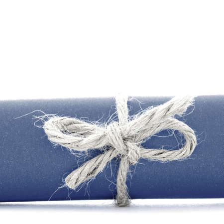 missive: Handmade natural rope knot tied on blue message tube, isolated