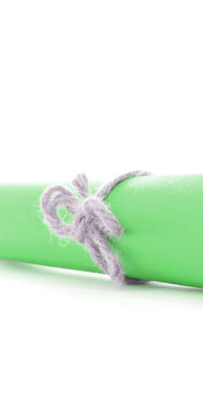 missive: Handmade natural rope node tied on green message roll, isolated Stock Photo