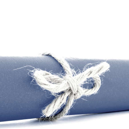 natural rope: Handmade natural rope bow tied on blue letter roll, isolated