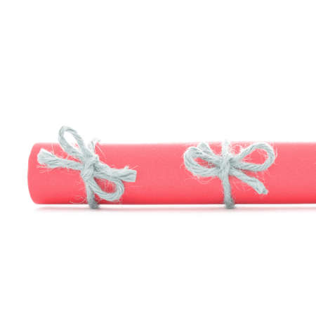 missive: Natural handmade cord bows tied on red paper scroll, isolated