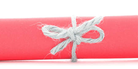 node: Handmade natural rope node tied on red letter tube, isolated
