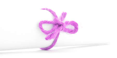 node: Handmade pink rope node tied on white letter scroll, isolated