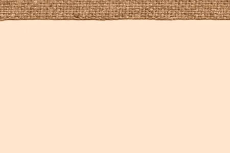 weft: Textile weft, fabric interior, camel canvas, stained material simplicity background