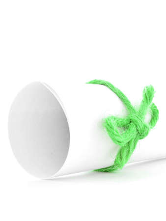 missive: Handmade green string knot tied on white message tube, isolated