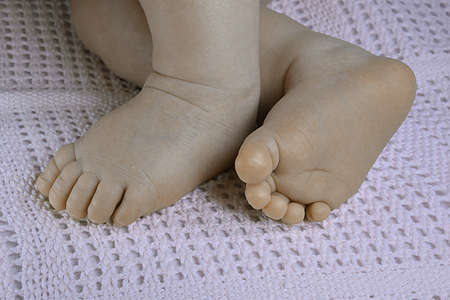 girl soles: Newborn baby small feet on blanket. Stock Photo