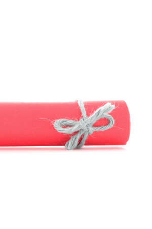 missive: Handmade natural string knot tied on red message scroll, isolated Stock Photo