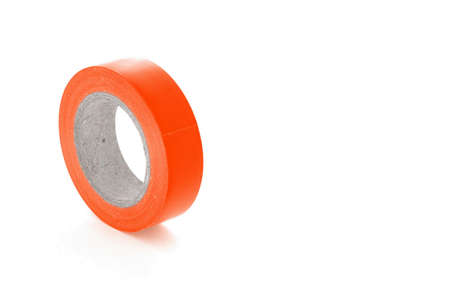 sellotape: Protective adhesive orange insulation tape roll, isolated on white background