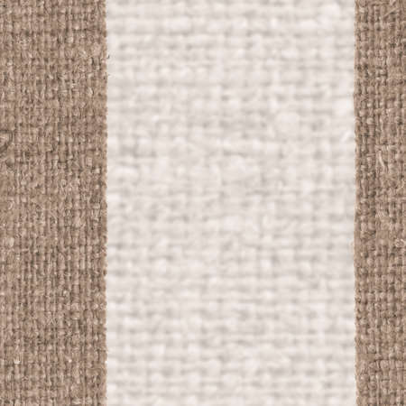weft: Textile sack, fabric element, yellow canvas, worn material retro-styled background Stock Photo