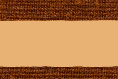 weft: Textile weft, fabric products, ochre canvas, hemp material art background Stock Photo