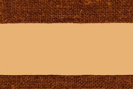 ochre: Textile weft, fabric products, ochre canvas, hemp material art background Stock Photo