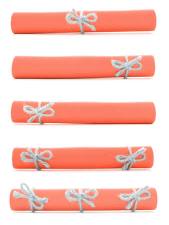 missive: Orange paper scrolls tied with handmade ropes and bows, isolated