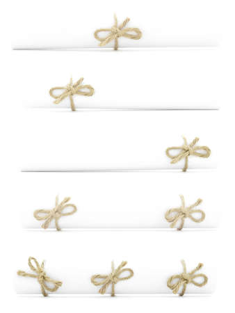 missive: White paper rolls tied with natural cords and nodes, isolated