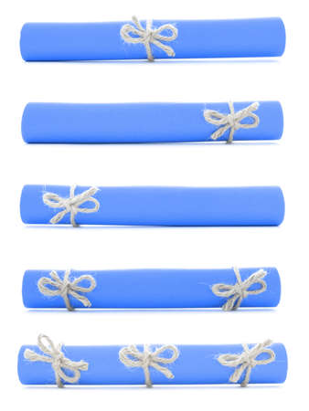 missive: Blue paper rolls tied with handmade cords and bows, isolated