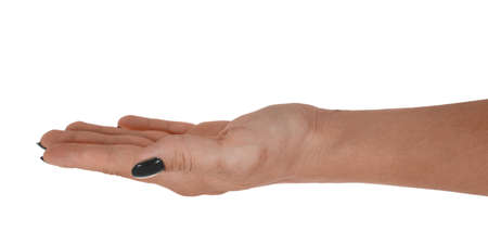 Open hand giving something, adult womans skin, black manicure. Isolated on white background.