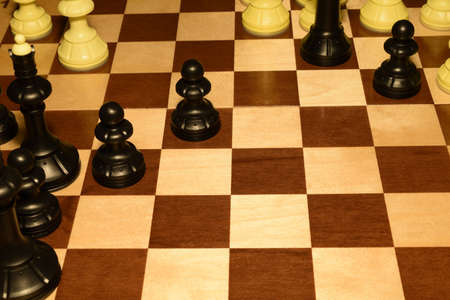 Chess board under the pieces like a strategy theme