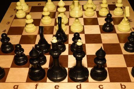 Chechered board with white pawns as a hobby backdrop