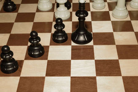 Chessboard and the chessmen as a game background Фото со стока