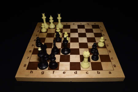 Wooden chessboard with the pieces for game background