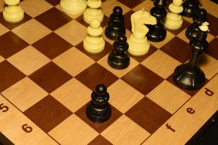 Wooden chessboard and white chessmen for sport backdrop Banco de Imagens