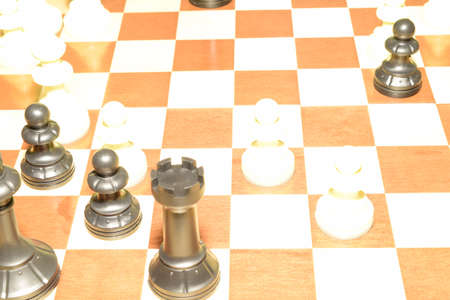 Chechered board under white pawns like a skill concept Foto de archivo