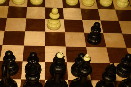 Wooden chess board and white pieces as a hobby background
