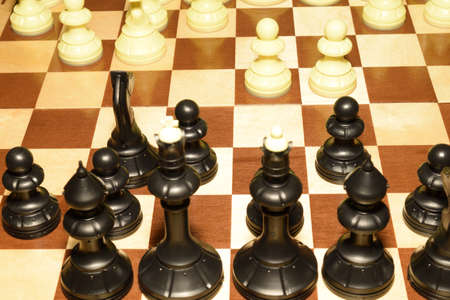Chessboard under black pawns like a skill background