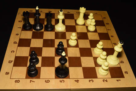 Chessboard and white chessmen as a game background