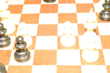 Chessboard with white chessmen for strategy theme Imagens