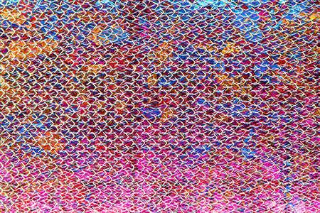 grating: Steel grating multi-colored pattern overlap.
