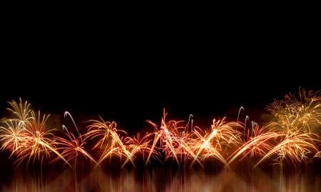 next year: Fireworks light up the night sky beautifully. Stock Photo