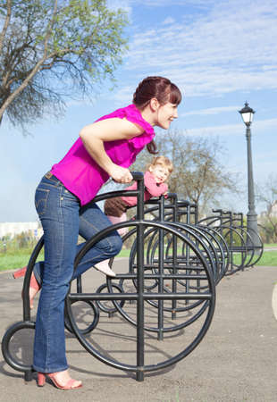 Mother and the daughter playing represent driving on bicycles photo
