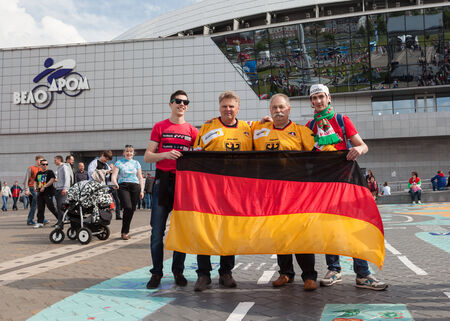 public spirit: MINSK, BELARUS - May 17, 2014  ICE HOCKEY WORLD CHAMPIONSHIP, MINSK-ARENA, The hockey fans from Germany and Belarus in the uniform of theirs national teams and German flag