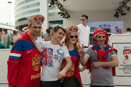 kokoshnik: MINSK, BELARUS - May 17, 2014  ICE HOCKEY WORLD CHAMPIONSHIP, MINSK-ARENA, The hockey fans from Russia with national accessories  kokoshnik  in the uniform of theirs national team Editorial