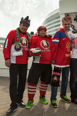 public spirit: MINSK, BELARUS - May 17, 2014: ICE HOCKEY WORLD CHAMPIONSHIP, MINSK-ARENA, The hockey fans from Russia and Belarus with national accessories in the uniform of theirs national teams