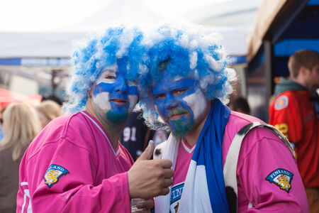 public spirit: MINSK, BELARUS - May 18, 2014  ICE HOCKEY WORLD CHAMPIONSHIP, MINSK-ARENA, The hockey fans from Finland in funny costumes and wigs