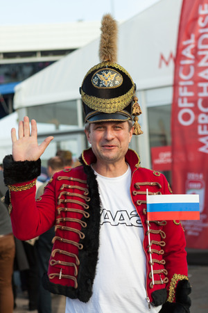 public spirit: MINSK, BELARUS - May 18, 2014  ICE HOCKEY WORLD CHAMPIONSHIP, MINSK-ARENA, The hockey fan from Russia in national vintage military uniform Editorial
