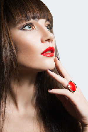 Beautiful Girl With Brown Straight Long Hair, Clear Skin,Green Eyes, Red Lips photo