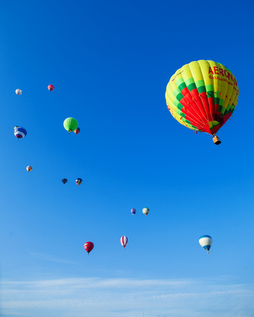 ballooning: Minsk, Belarus - September 13, 2014: The FIRST OPEN CHAMPIONSHIP of Belarus on aeronautic sports.Bunch of colored balloons in blue sky