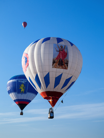Minsk, Belarus - September 13, 2014: The FIRST OPEN CHAMPIONSHIP of Belarus on aeronautic sports.Three colored balloons in blue sky