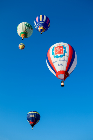 Minsk, Belarus - September 13, 2014: The FIRST OPEN CHAMPIONSHIP of Belarus on aeronautic sports.Bright colored balloons fly in blue sky