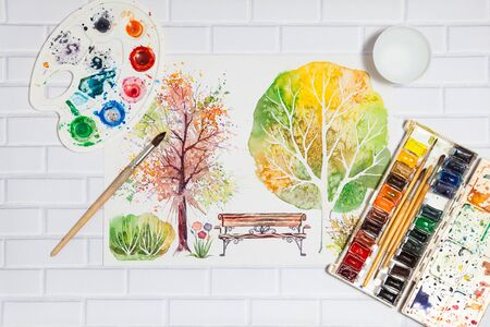 pictorial art: Hand Drawn Bright Sketch with autumn trees, bench, bush and lying flat paints, paintbrushes and palette on the white brick background - concept of human creativity, top view