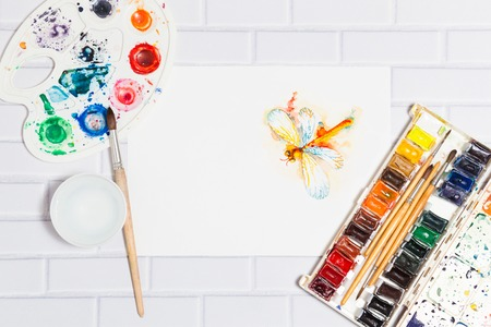 pictorial art: Sketch of Orange Watercolor Dragonfly And Paints Stock Photo