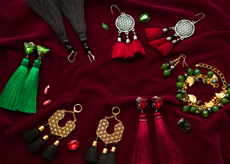 Handmade jewelry on the vinous velvet background