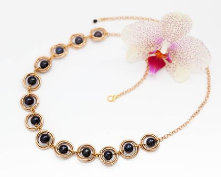 Handmade golden necklace with black pearls
