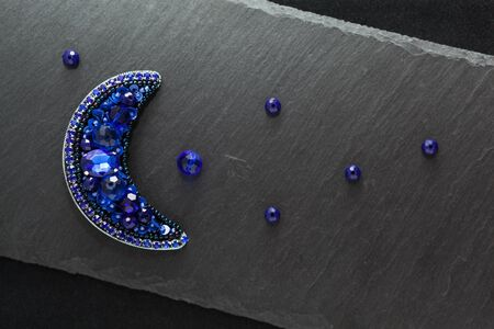 Dark background with blue moon handmade brooch