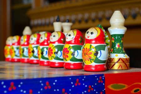 Chess figure nesting doll. Matryoshka. Russian wooden toy. Stock Photo
