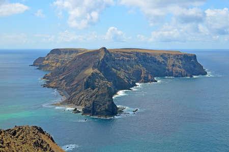 Fantastic view of a rocky uninhabited island Ilheu da Cal from Ponta da Calheta, Porto Santo, Madeira, Portugal.